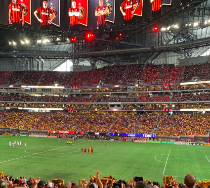 Fans stand united in Mercedes Benz Stadium as they cheer on their team against New England Revolution on October 6.