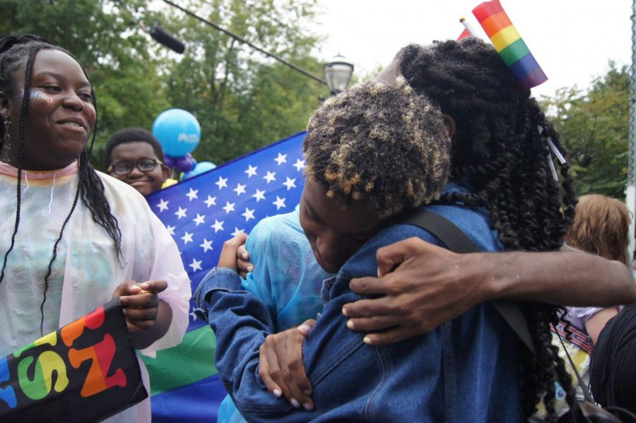 Isiah+Ramsby+and+Gabrielle+Merit%2C+co-leaders+of+the+GSA%2C+hug+as+the+parade+marches+on+behind+them.+%22This+is+my+first+Pride%2C+and+I%27ve+never+felt+so+open+about+myself+and+comfortable%2C+%22+Merit+said.+%22It%27s+so+loving+and+the+environment+is+really+nice.%22