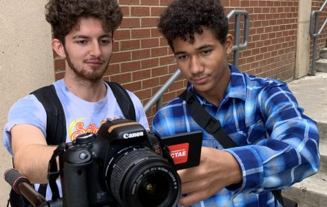 Junior Rylan Neil pictured filming a video for GNN with another videographer.
