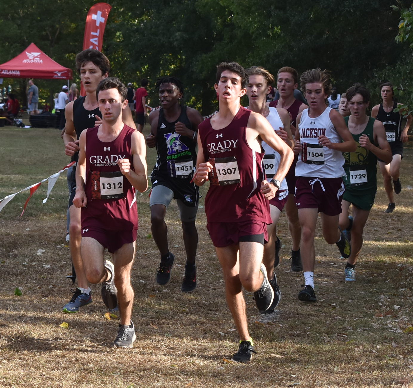 FINISH STRONG: Senior Bram Mansbach (left) and senior Kavi Jakes (right)  lead the pack at the APS City Championships on Oct. 8.  Mansbach went on to finish first place and Jakes went on to finish second overall. The Knights' placed first overall in the meet.