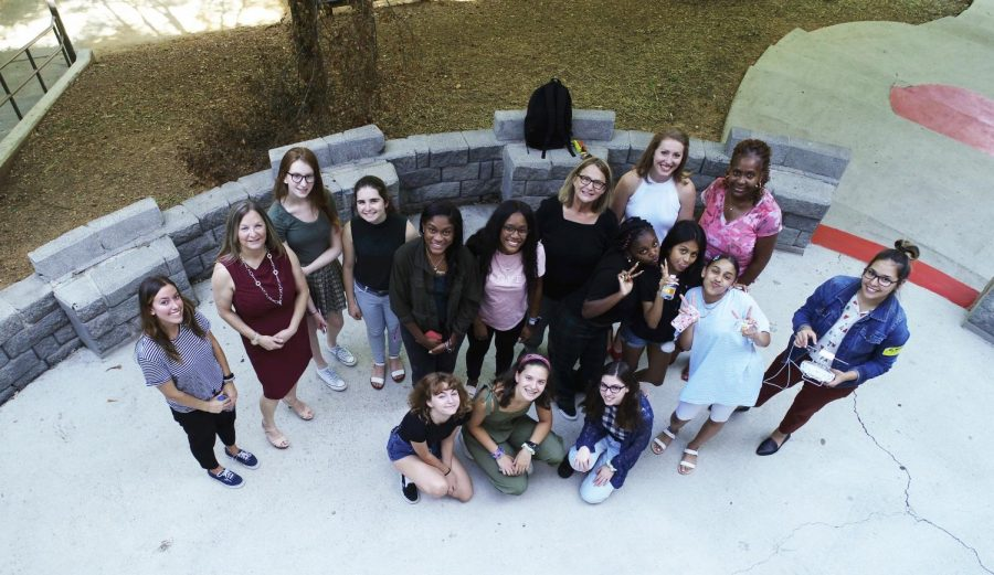 The Women in Transportation club takes a photo by drone at a meeting with female drone pilots.