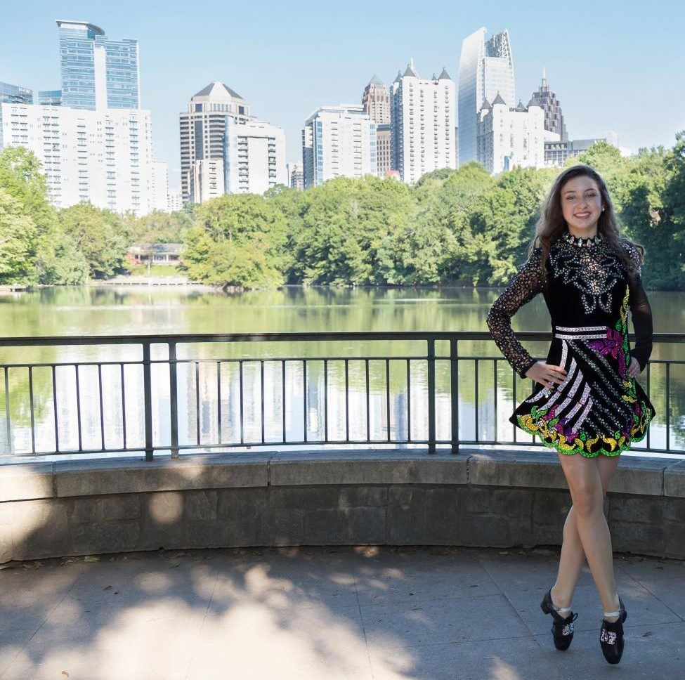 Sparkle and Bling: Freshman Aisling Mahony stands in Piedmont park for a photoshoot in her Irish dancing costume. The costume is one of her favorite parts of Irish dancing.
