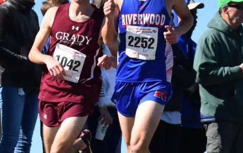 Senior Bram Mansbach (left) races Eli Hoffenfeld of Riverwood (right) to a 5th place finish and All-State honors in the Class 5A state cross country meet on Nov. 1 in Carrollton. Grady's boys cross country team finished 3rd overall.