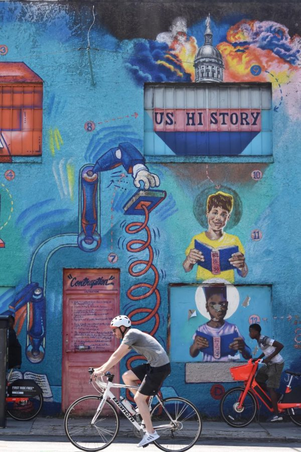 Paragraphalizer, a mural painted by artist Fabian Williams, is a part of the Contraception collection is on Edgewood Avenue. He painted an image to resemble how African American history is often lost in textbooks and education.