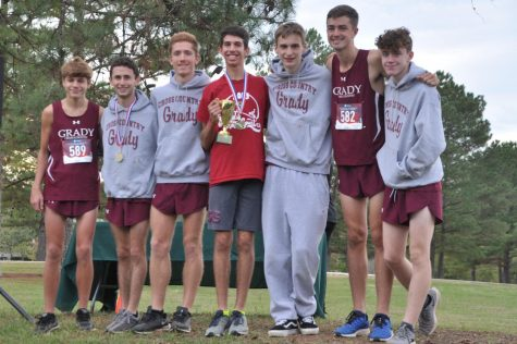 The boys cross country team celebrates winning the second place trophy at the 2019 Region 6AAAAA meet. Many of these athletes also compete on the track team, one of the many sports greatly affected by the COVID-19 outbreak. Five out of the seven pictured are seniors.