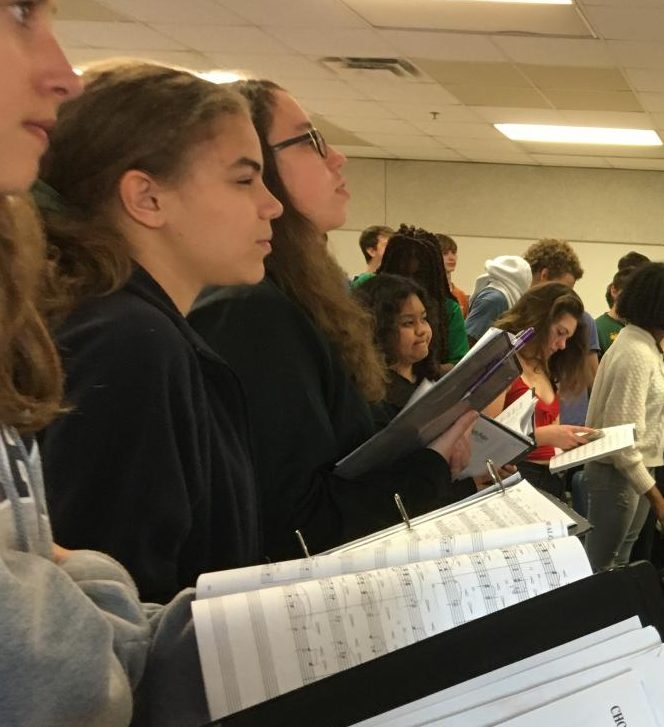 Grady chorus students stay after school, to practice well in advance of their next