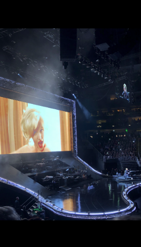 Dedicating his song to Marilyn Monroe, Elton John played Candle in the Wind with photos of her in the background.