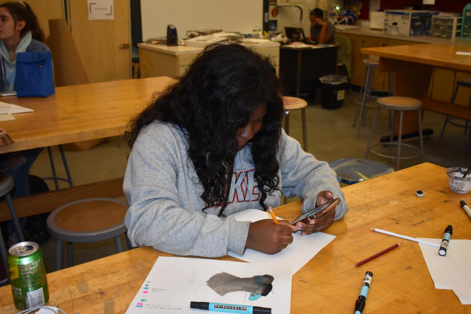 Sophomore Jayla Davis works on her design for a corset in Valerie William's Costume Tech class. The class is working on corsets as a study in clothing items specific to historical timelines.