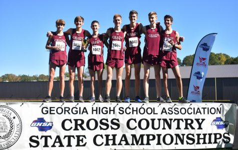 STATE RECOGNITION: The boys cross country team stands proud on the podium at the state 5A meet after finishing third overall. Two of the Knights seniors Kavi Jakes(8th) and Bram Mansbach(5th) finished in the top 10 for the boys in the meet.