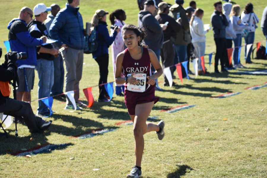 Senior Marisa Lopata sprints down the finish chute. Lopata finished 90th overall and sixth for the Knights. She was the only senior to run the race.
