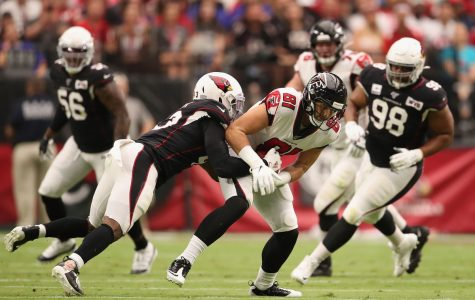 Falcons Tight End Austin Hooper is being tackled by defenders of the Arizona Cardinals. The Falcons would end up losing this game after a heartbreaking missed extra point by kicker Matt Bryant, making them 1-5.