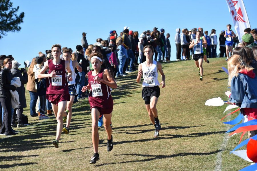 Senior Luke Langan and sophomore Everett Schroeder pace each other on the first lap of the state 5A meet. Schroeder finished 17th overall and third for the Knights while Langan finished 24th overall and fourth for the Knights. The Knights took home third place in the meet.