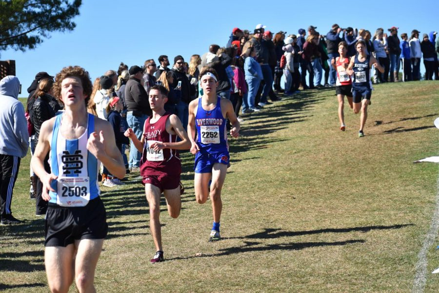 Senior Bram Mansbach runs through the state 5A meet. Mansbach finished fifth overall and first for the Knights, helping to lead the team to third place in the meet.