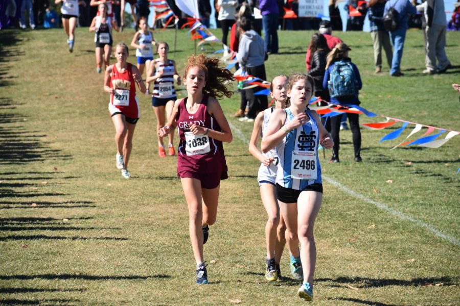 Freshman Emilia Weinrobe chases after two other competitors in the state 5A meet on Nov. 1. Weinrobe finished 30th overall and second for the Knights.