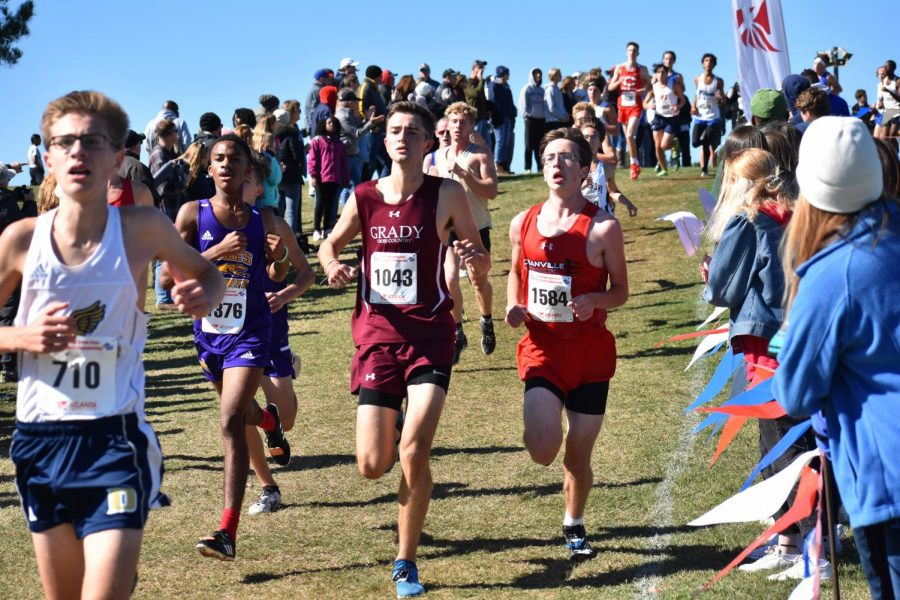 Senior Jack Palaian pushes himself through the state 5A meet. Palaian finished 76th overall and sixth for the Knights.
