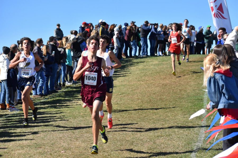Senior Kavi Jakes makes long strides down the course in the state 5A meet. Jakes finished 8th overall and second for the Knights.