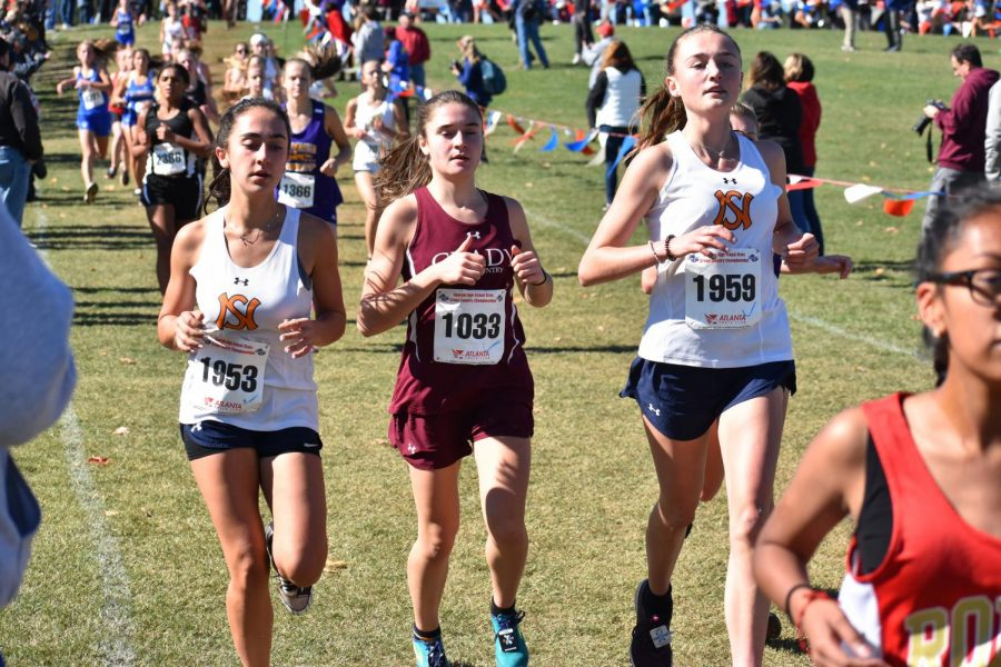 Junior Sadie Zweben races against two other competitor from North Springs in the state 5A meet. Zweben finished 92nd overall and 7th for the Knights.