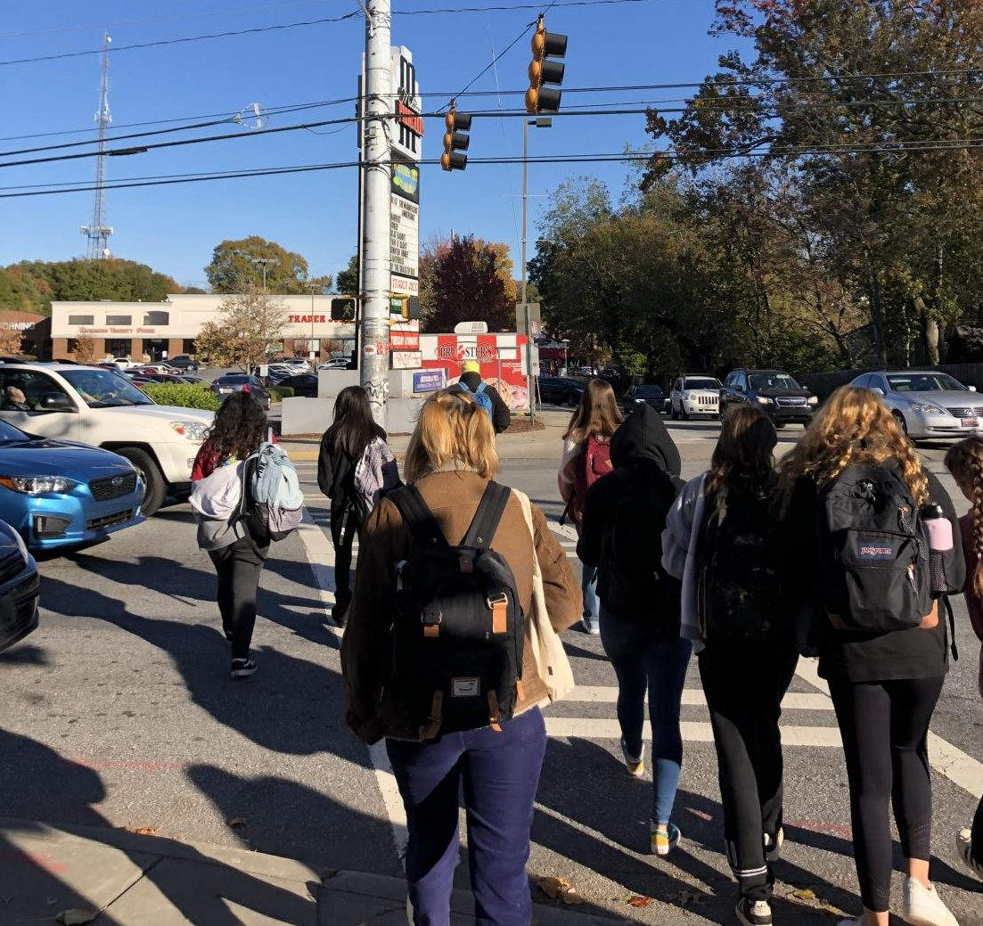 Students cross busy intersection after school at the corner of 8th Street and Monroe Drive.