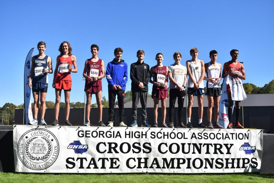 TOP 10: The top 10 finishers for the boys 5A state race line up on the podium. Knights runners and seniors Kavi Jakes finished 8th overall and Bram Mansbach finished 5th.
