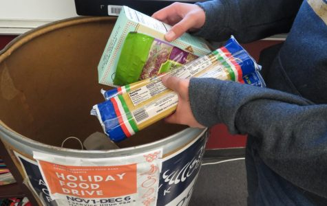 Helping the hungry: Sophomore Will Charlop donates food for the Grady Food Bank Club's food drive. Dry goods and non-perishable items are accepted for the drive.