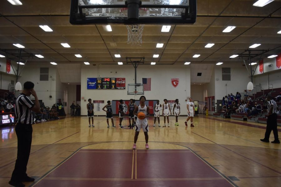Senior Kyle Hanson takes a free throw after a KIPP player was charged with a technical foul. In high school basketball, as well as college and professional, the eight other players on the court are required to stand behind the half-court line.