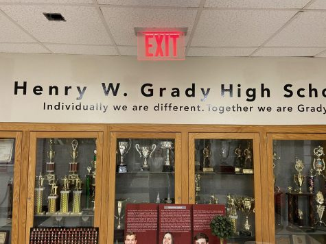 """Henry W Grady High School"" is written on the wall of the lobby of Grady High School. At this phase in the name changing process, the Grady community is currently in the middle of deliberations over what name should be recommended to the Board for consideration."