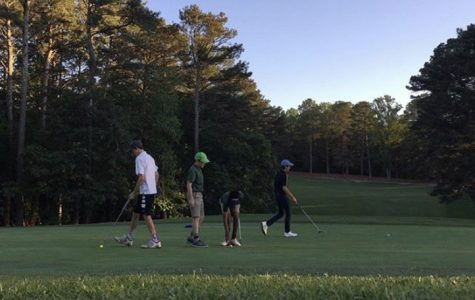 Juniors Daniel Poss and Drew Bradshaw tee-up with friends to play a casual game of golf.