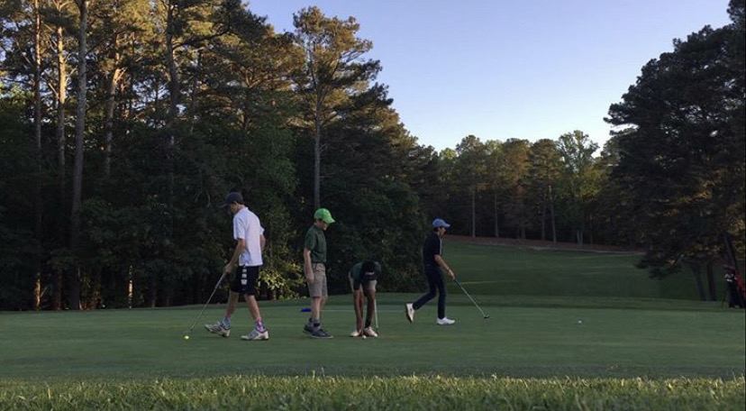 Juniors+Daniel+Poss+and+Drew+Bradshaw+tee-up+with+friends+to+play+a+casual+game+of+golf.