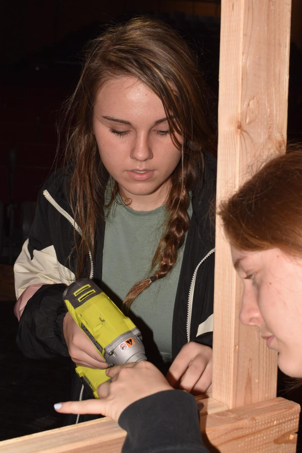 Freshman+Virginia+Maguire+uses+a+drill+to+construct+the+set+for+%E2%80%9CSweeney+Todd%2C%E2%80%9C+her+first+Grady+Drama+production.+Students+learn+technical%2C+mathematical+and+artistic+skills+on+crew.