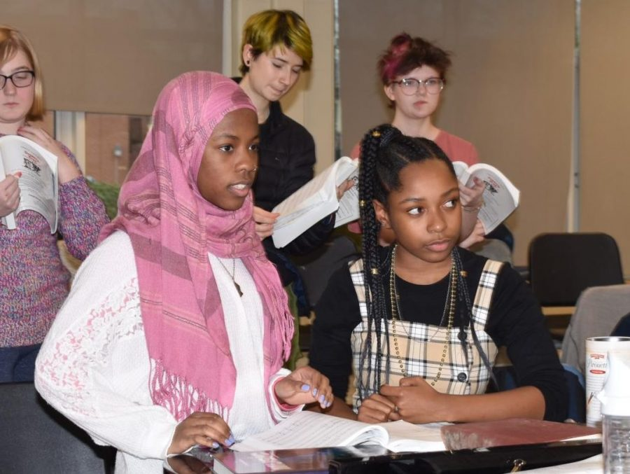 Junior Inaya Abdul-Haqq (left), who plays Bird Seller, and Madison Ford, who plays Tobias, run through their scenes during vocal rehearsal with Mr. Hill.