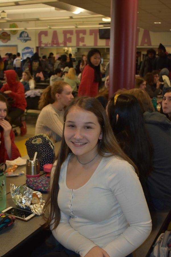 Sophomore Meg McGahan eats lunch with her table of friends.