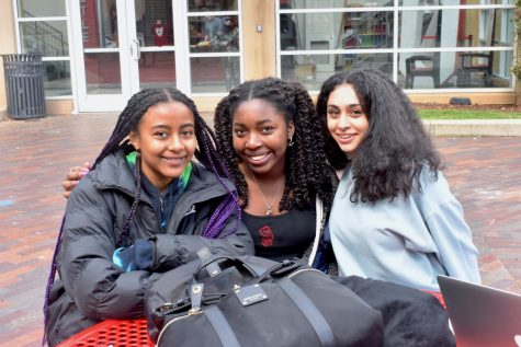 (Left to right) Seniors Zoe White, Lila Chiles, and Noor Gebba sit together outside during lunch.