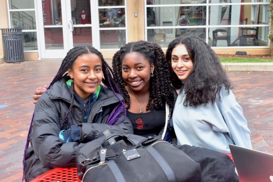 (Left to right) Seniors Zoe White, Lila Chiles and Noor Gebba sit together outside during lunch.
