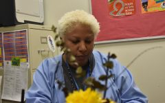 Nurse Wanda Taylor sits in her office as she fills out paperwork for the end of the day.