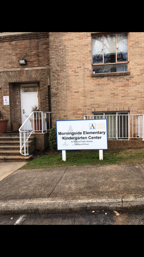 This is the back of the Metro City Church.  All of the elementary school entrances and exits are clearly marked with signs like these. The annex is currently used for Morningside Elementary, and in the future Springdale Park Elementary.