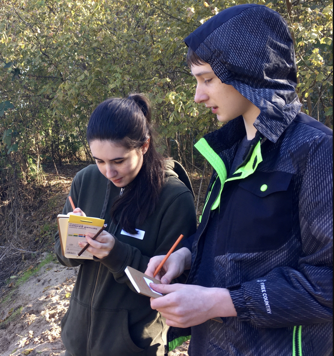 Maura O'Sullivan, co-founder of Branch Out Initiative, teaches her younger brother, Finn O'Sullivan, about wildlife. Branch Out specializes in leading inclusive nature hikes.