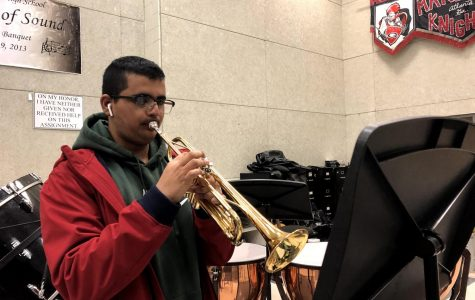 """PRACTICE MAKES PERFECT: Trumpeter Bhuvan Saraswat practices """"Shenandoah"""", one of the band's pieces for their LGPE, or large group performance evaluation. The band's LGPE is March 11th."""