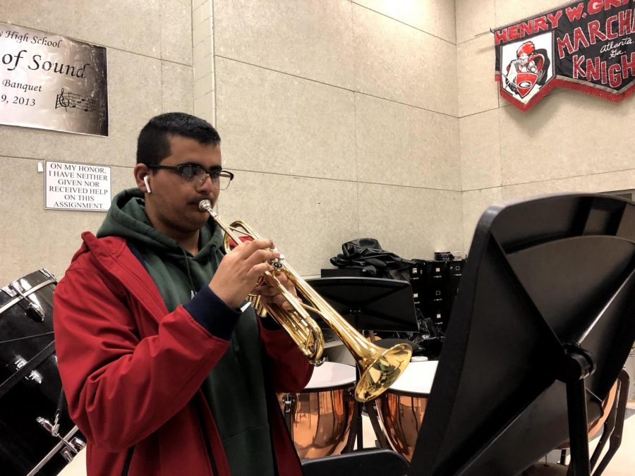 PRACTICE+MAKES+PERFECT%3A+Trumpeter+Bhuvan+Saraswat+practices+%E2%80%9CShenandoah%E2%80%9D%2C+one+of+the+band%E2%80%99s+pieces+for+their+LGPE%2C+or+large+group+performance+evaluation.+The+band%E2%80%99s+LGPE+is+March+11th.