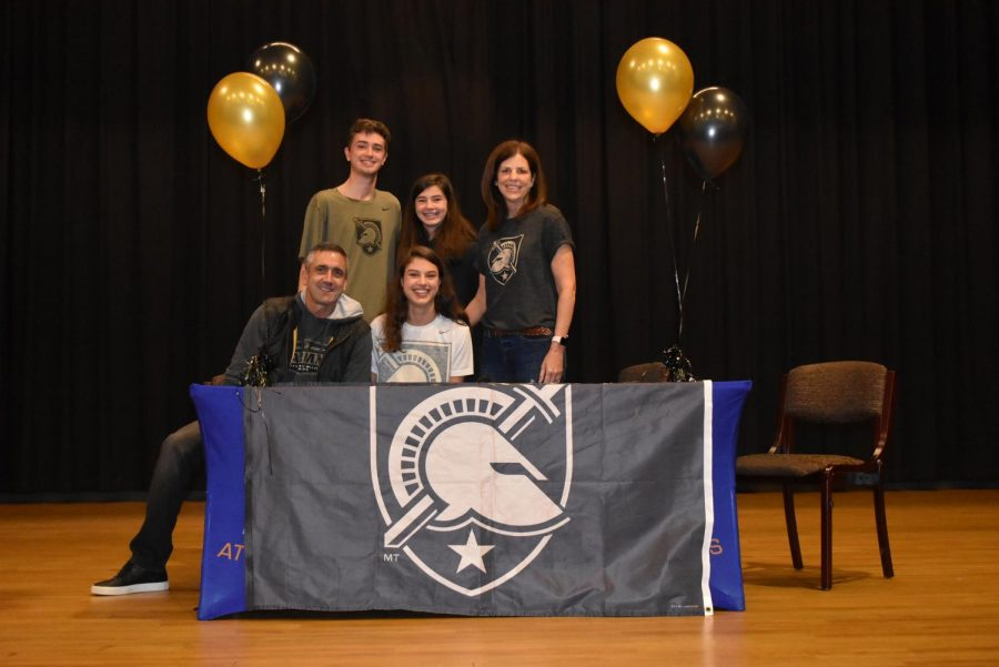 Soccer player Kaitlin Palaian sits with her family after signing with the U.S. Military Academy. She is the second Grady student to attend the school in West Point, NY since the class of 2018.