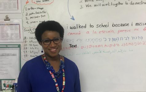 """ESOL teacher Che Andrews displays the teaching methods she uses on her whiteboard. The """"Do Now"""" consists of evaluating the sentence: """"I walked to school because I missed the bus."""""""