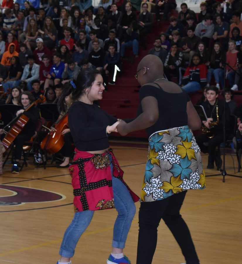 Junior Lucy Strohl and XXX represent the French program by dancing a traditional Afro-Caribbean dance.