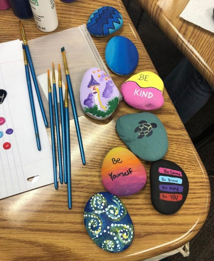 Arts and Crafts Club members painted rocks with inspiring messages to leave around the Grady campus.