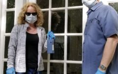 Real estate agents and Grady parents Lee and Darlene Gillespy take proper safety precautions when showing houses.
