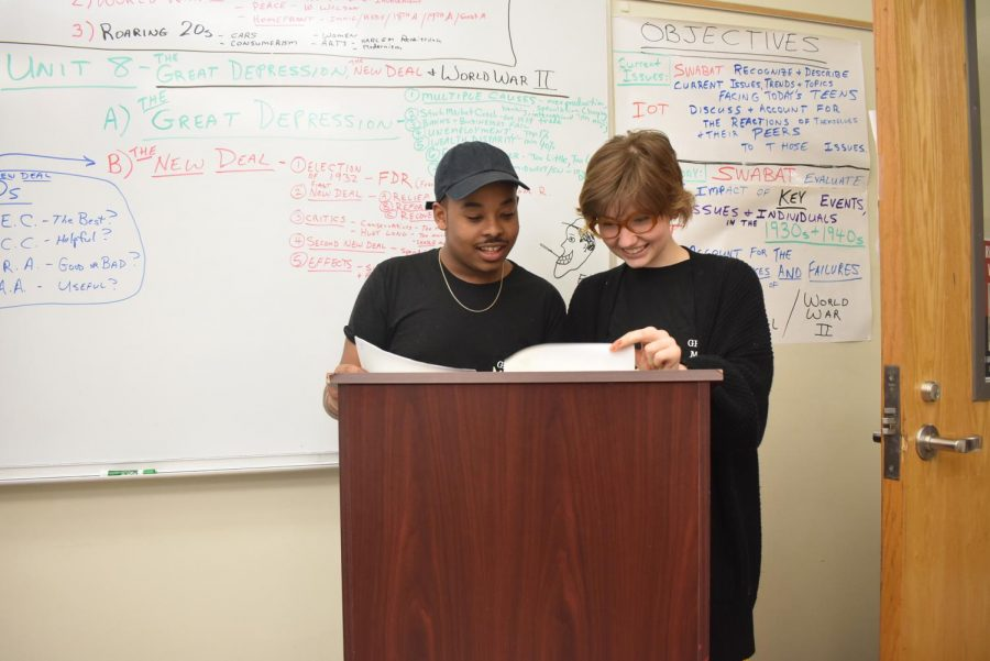Sophomore Sophie Markovic and junior Keontae Gui prepare their speech on voter suppression.