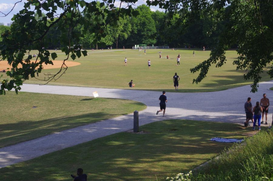 People take advantage of the warm weather and relatively uncongested Piedmont Park to spend time outside. The park has remained in frequent use by residents.