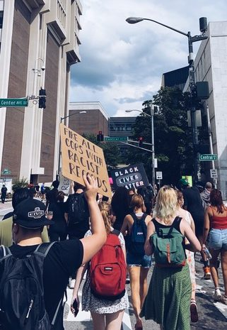 Participants in the Justice For Us protest march through the streets of Atlanta with signs demanding justice for victims of police brutality on May 29.