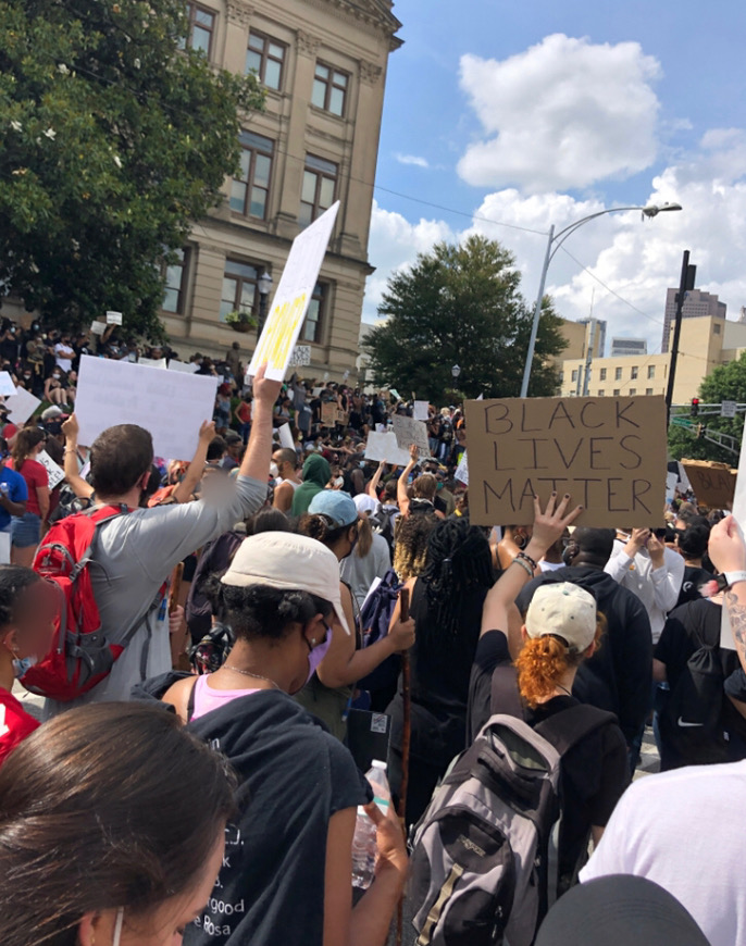Nonviolent protesters marched to the Georgia State Capitol and gathered to protest police brutality on May 29, 2020 in downtown Atlanta. Some raise their fists as a symbol of solidarity.
