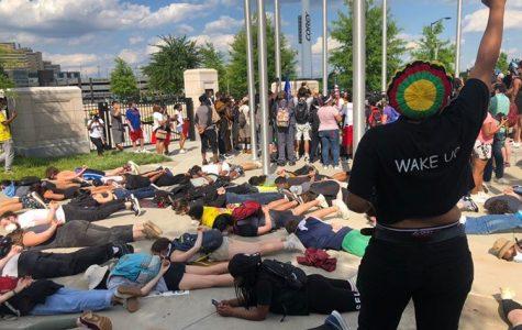 Protestors participate in