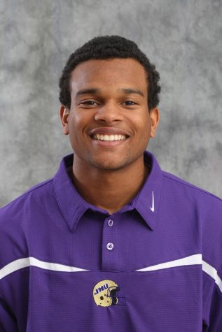 Gerren Griffin poses for his player photo as a redshirt junior playing football at James Madison University.