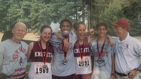 (Left to Right): Dick Buerkle, Rebecca Tolmach, Saji Girvan, Kiah Vernon, Nick Stephens, and Jeff Cramer are seen consoling each other after a cross country meet in 2002.